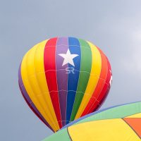Two colorful hot air balloons flying high in the sky