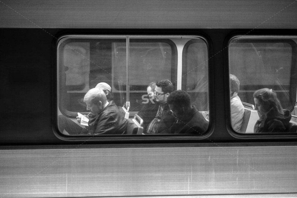 People riding the train heading to work in Washington DC