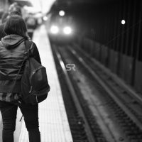 Female tourist watching the train to arrive   in Times Square NYC