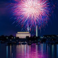 Purple & Blue  Fireworks launching high in the sky over the Washington Monunment in DC