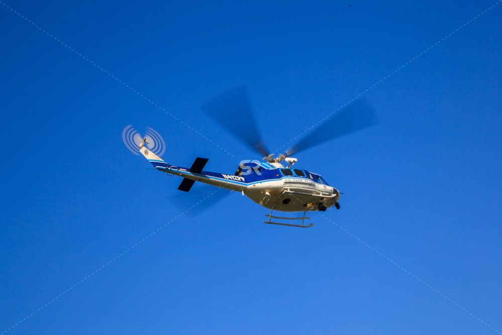 US Park Police Helicopter flying in Washington DC on a sunny day