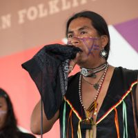 Young Native American man singing