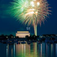 Green Fireworks launching high in the sky over the Washington Monunment in DC