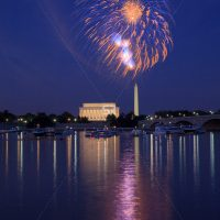Colorful Fireworks launching high in the sky over the Washington Monunment in DC