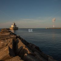 Rocky path leading to dock house at sunrise in Oswego New York