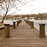 Wide shot of lake dock  in the winter