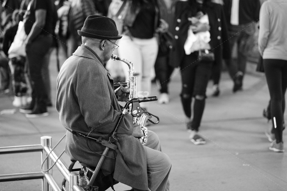 Saxophone player in a street of New York near Times Square
