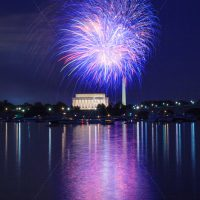 Blue & White Fireworks launching high in the sky over the Washington Monunment in DC