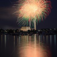 Red & Green Fireworks launching high in the sky over the Washington Monunment in DC