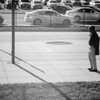 Man waiting at the bus stop by the station in Rockville