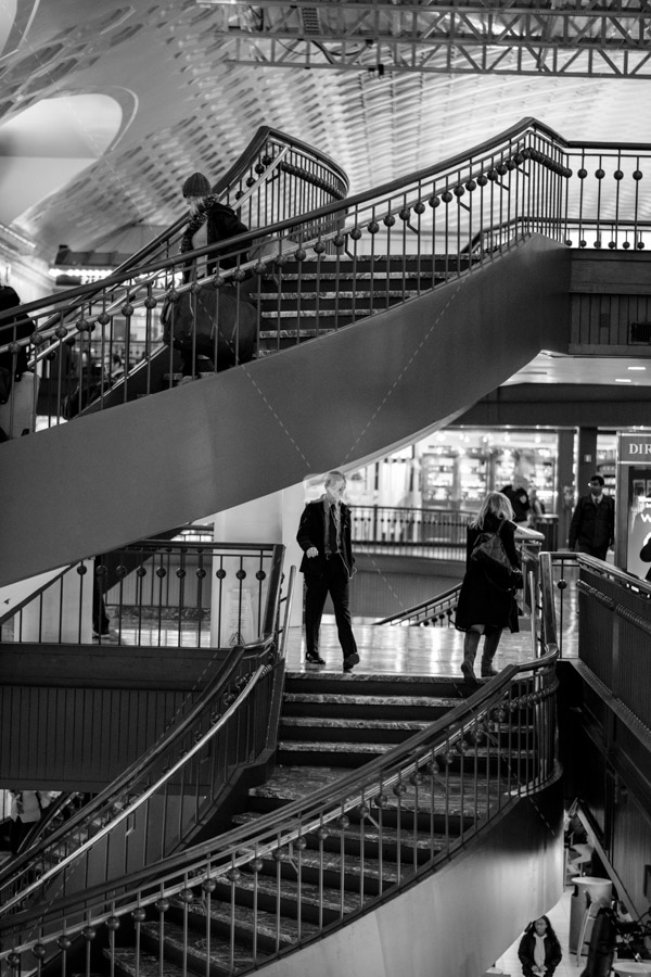 Two flights of stairs at union station with people walking on them in Washington DC