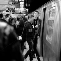 People  boarding the subway train in Times Square NYC