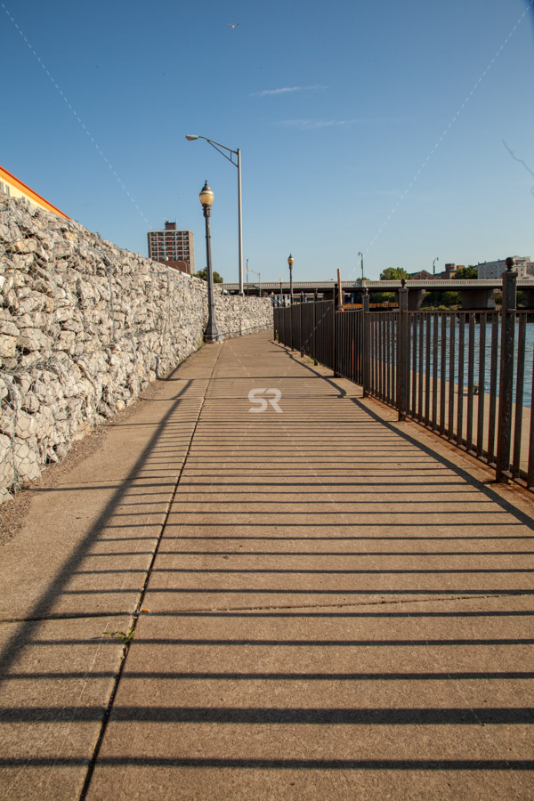 Sidewalk by the harbor in the city on a beautiful sunny day in Oswego New York