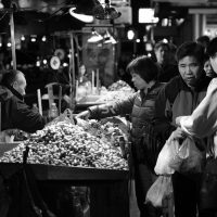 Older man selling vegetables  in Chinatown