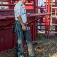 Cowboy dressed up in his full outfit ready for the rodeo