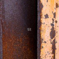 An old rusted door with spots