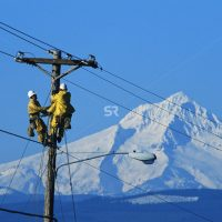 Workers repair electric power line