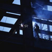 Construction workers welding iron