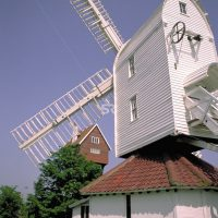 Old style windmill on sunny day
