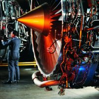 Worker inspects jet engines