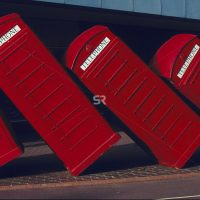 Telephone booths tipped