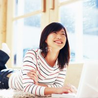 Asian woman on laptop