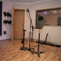 Recording studio room with microphone