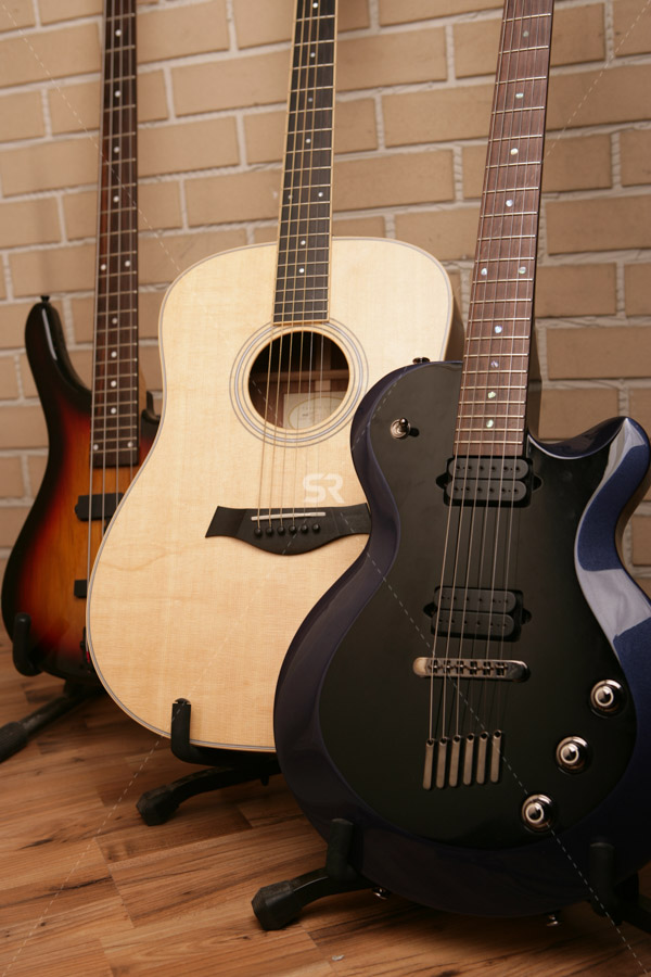 Guitars on stands against wall