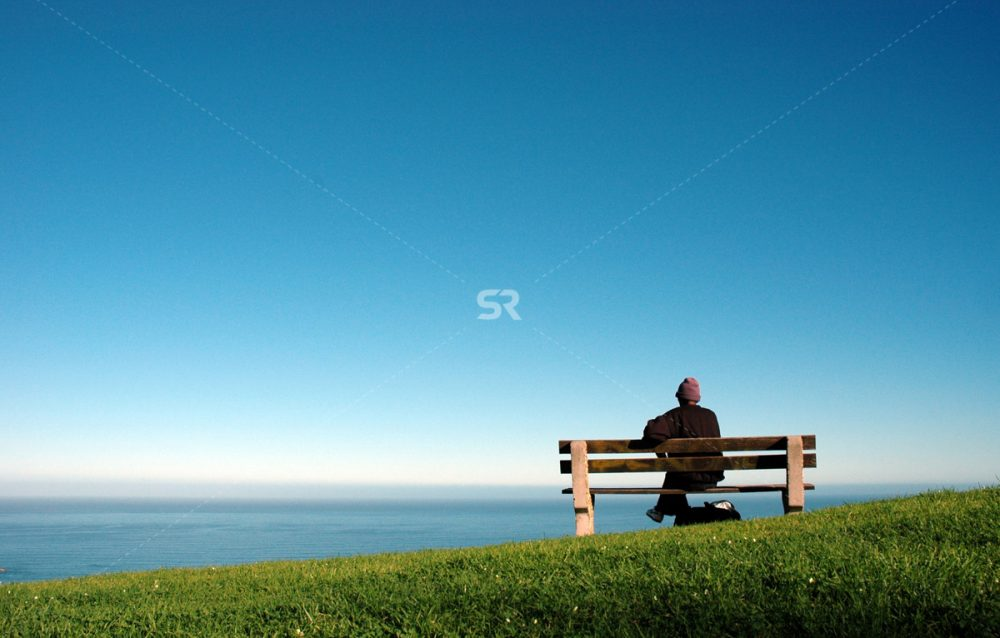 Person enjoys scenic look from bench