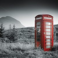 Telephone booth in field