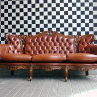 Sofa against checkered wall