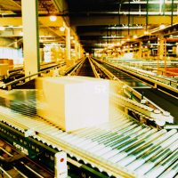 Conveyor belt with boxes in a warehouse