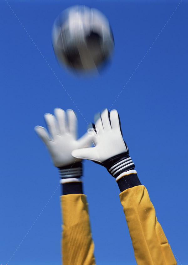 Soccer goalie catches ball