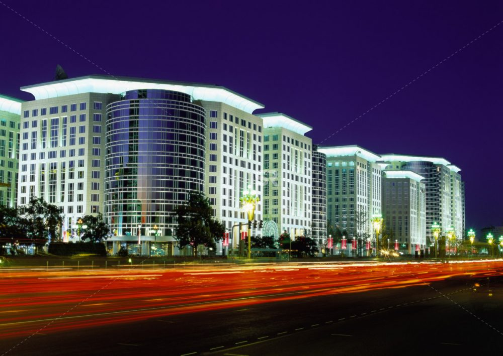 Long exposure of buildings with car light trails in foreground