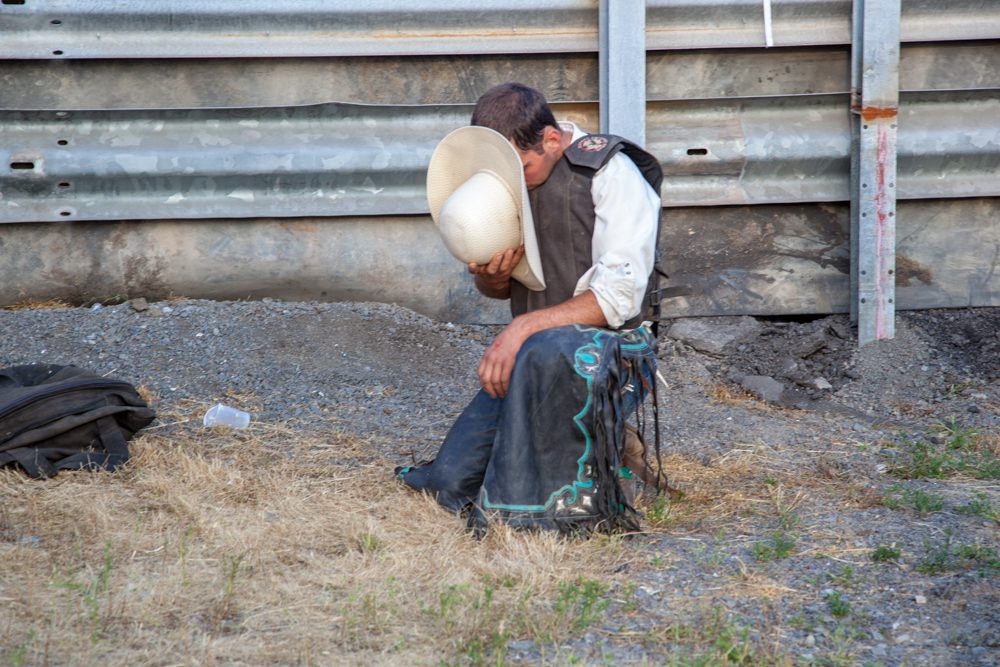 Cowboy praying before the rodeo