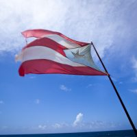 The Flag of Puerto Rico near the ocean